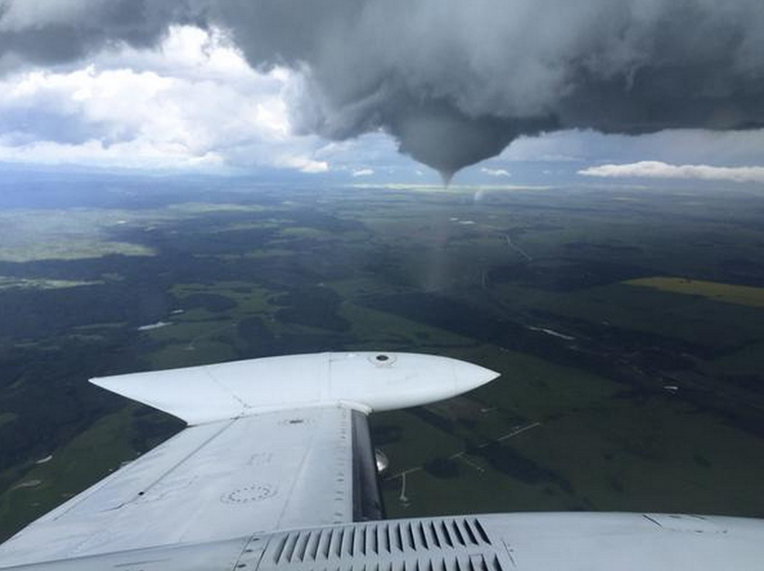 The tornado near Priddis, AB as seen from air by cloud seeders. (Source: Twitter - @Ringosmyuncle)